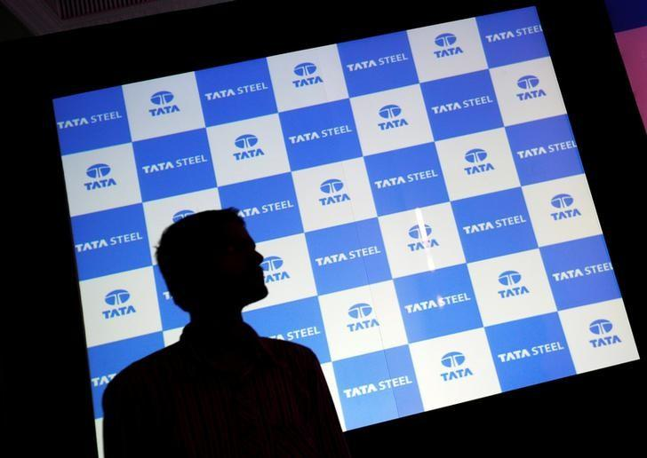 A man walks past a screen displaying Tata Steel logo before the start of a news conference in Mumbai, May 25, 2016. REUTERS/Danish Siddiqui/Files