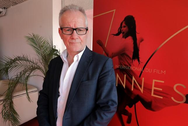 70th Cannes Film Festival - Cannes, France. 16/05/2017 - Cannes Film Festival general delegate Thierry Fremaux poses near the official poster, featuring actress Claudia Cardinale, on the eve of the start of the Festival.  REUTERS/Eric Gaillard