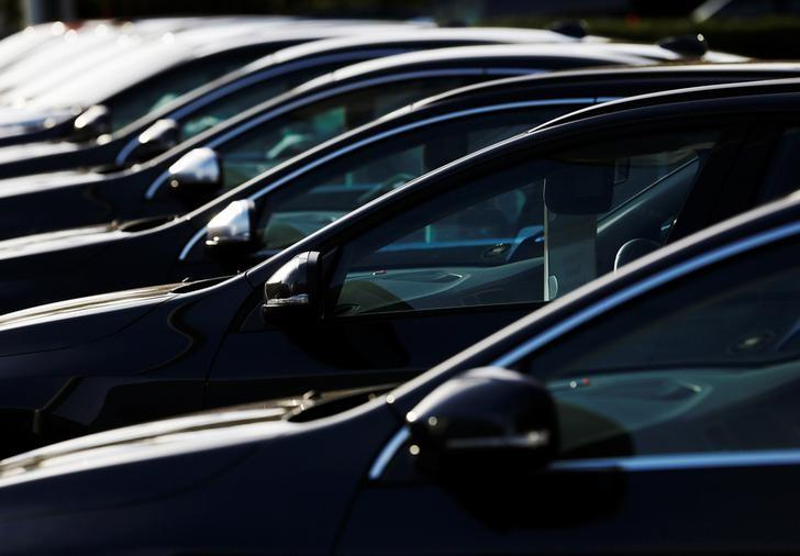 Cars are displayed outside a Volvo showroom in west London, Britain October 4, 2013. REUTERS/Luke MacGregor/Files