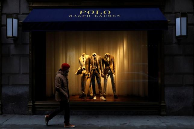 FILE PHOTO: A man walks past Ralph Lauren Corp.'s  flagship Polo store on Fifth Avenue in New York City, U.S., April 4, 2017.    REUTERS/Brendan McDermid