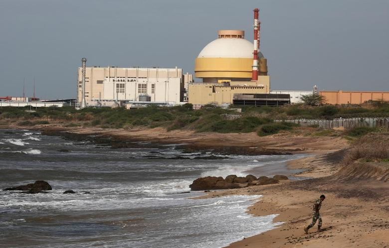 FILE PHOTO: A policeman walks on a beach near Kudankulam nuclear power project in the southern Indian state of Tamil Nadu, September 13, 2012. REUTERS/Adnan Abidi/File photo