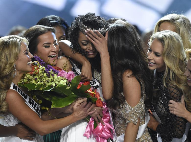Miss District of Columbia Kara McCullough reacts after being crowned 2017 Miss USA. REUTERS/David Becker