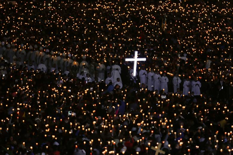 Pilgrims attend a candlelight vigil at the Catholic shrine of Fatima, Portugal May 12, 2017. REUTERS/Pedro Nunes