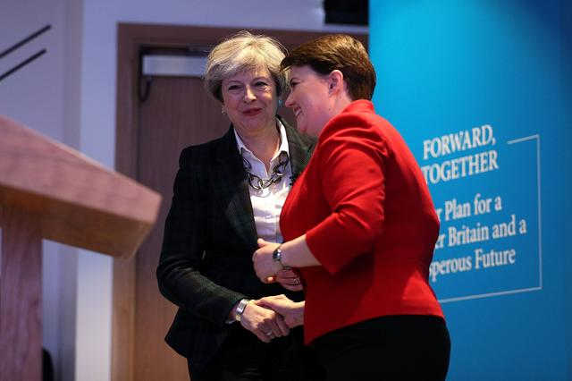 Scottish Conservative leader Ruth Davidson speaks to Britain's Prime Minister Theresa May as they launch the Scottish manifesto in Edinburgh, Scotland, Britain May 19, 2017. REUTERS/Dan Kitwood/Pool