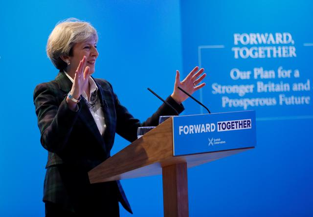 Britain's Prime Minister Theresa May gives a speech during the launch of the Scottish Conservative manifesto in Edinburgh, Scotland, Britain May 19, 2017. REUTERS/Russell Cheyne