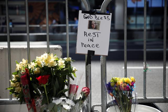 Flowers and a photograph of Alyssa Elsman, the 18 year old woman who was killed when a speeding vehicle struck pedestrians on the sidewalk Thursday is seen at a makeshift memorial at the scene of the incident outside the 3 Times Square building in Times Square in New York City, U.S., May 19, 2017. REUTERS/Mike Segar