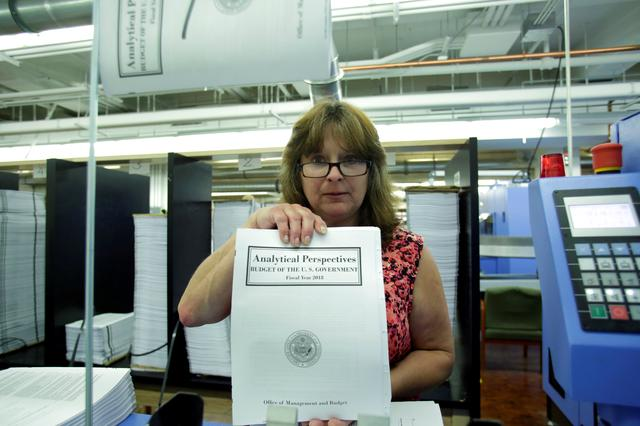 President Donald Trump's FY2018 budget is seen during printing process at the Government Publishing Office in Washington, U.S., May 19, 2017. REUTERS/Yuri Gripas