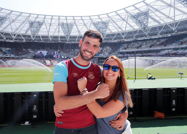 Lawyer Ismael Vitulli from Buenos Aires, poses for a photograph with his girlfriend, at a Premier League soccer match between West Ham United and Swansea City in London, Britain April 8, 2017.  REUTERS/Eddie Keogh