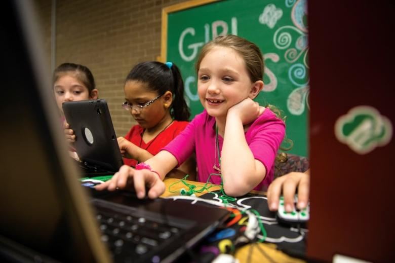 A Girl Scout works on a laptop computer, in a photo released June 21, 2017.   Girl Scouts of the USA/Handout via REUTERS