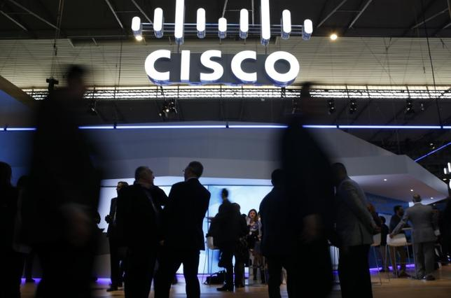 Visitors walk past Cisco's booth during Mobile World Congress in Barcelona, Spain, February 27, 2017. REUTERS/Paul Hanna