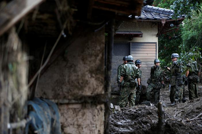 Japanese Self-Defense Force soldiers conduct search and rescue operation at a damaged house caused by a heavy rain in Asakura, Fukuoka Prefecture, Japan July 9, 2017. Issei Kato
