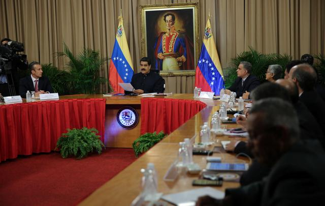 Venezuela's President Nicolas Maduro (C) speaks during a meeting with members of the Defense Council of the Nation in Caracas, Venezuela July 18, 2017. Miraflores Palace/Handout via REUTERS