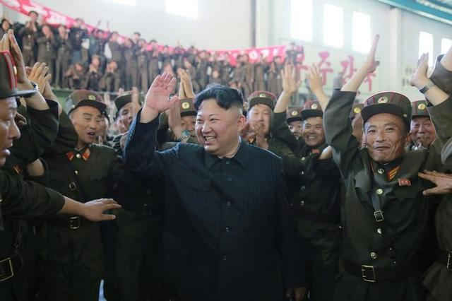 FILE PHOTO: North Korean leader Kim Jong Un reacts with scientists and technicians of the DPRK Academy of Defence Science after the test-launch of the intercontinental ballistic missile Hwasong-14 in this undated photo released by North Korea's Korean Central News Agency (KCNA) in Pyongyang July 5, 2017. KCNA/via REUTERS