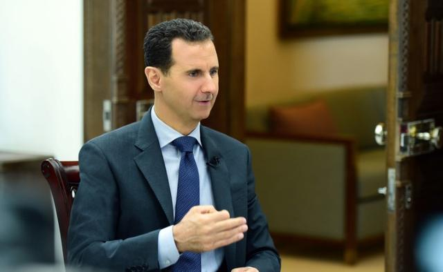 FILE PHOTO: Syria's President Bashar al-Assad speaks during an interview with RIA Novosti and Sputnik in this handout picture provided by SANA on April 21, 2017, Syria. SANA/Handout via REUTERS