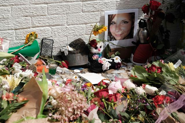 Flowers and a photo of car ramming victim Heather Heyer lie at a makeshift memoriall in Charlottesville, Virginia,  August 13, 2017. REUTERS/Justin Ide
