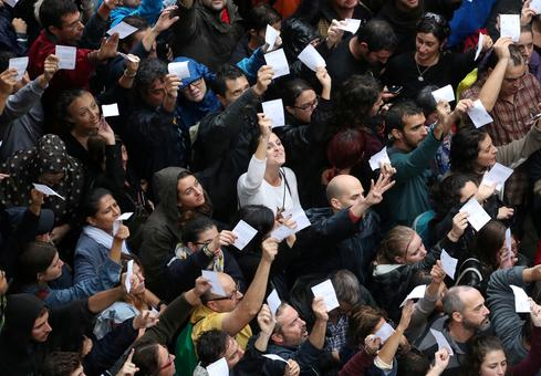 Defiant Catalans vote despite crackdown
