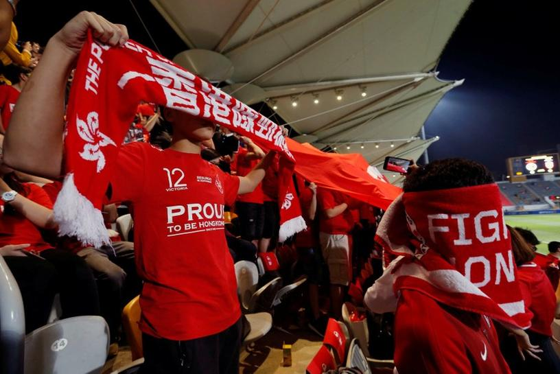 Hong Kong soccer fans defy China anthem law