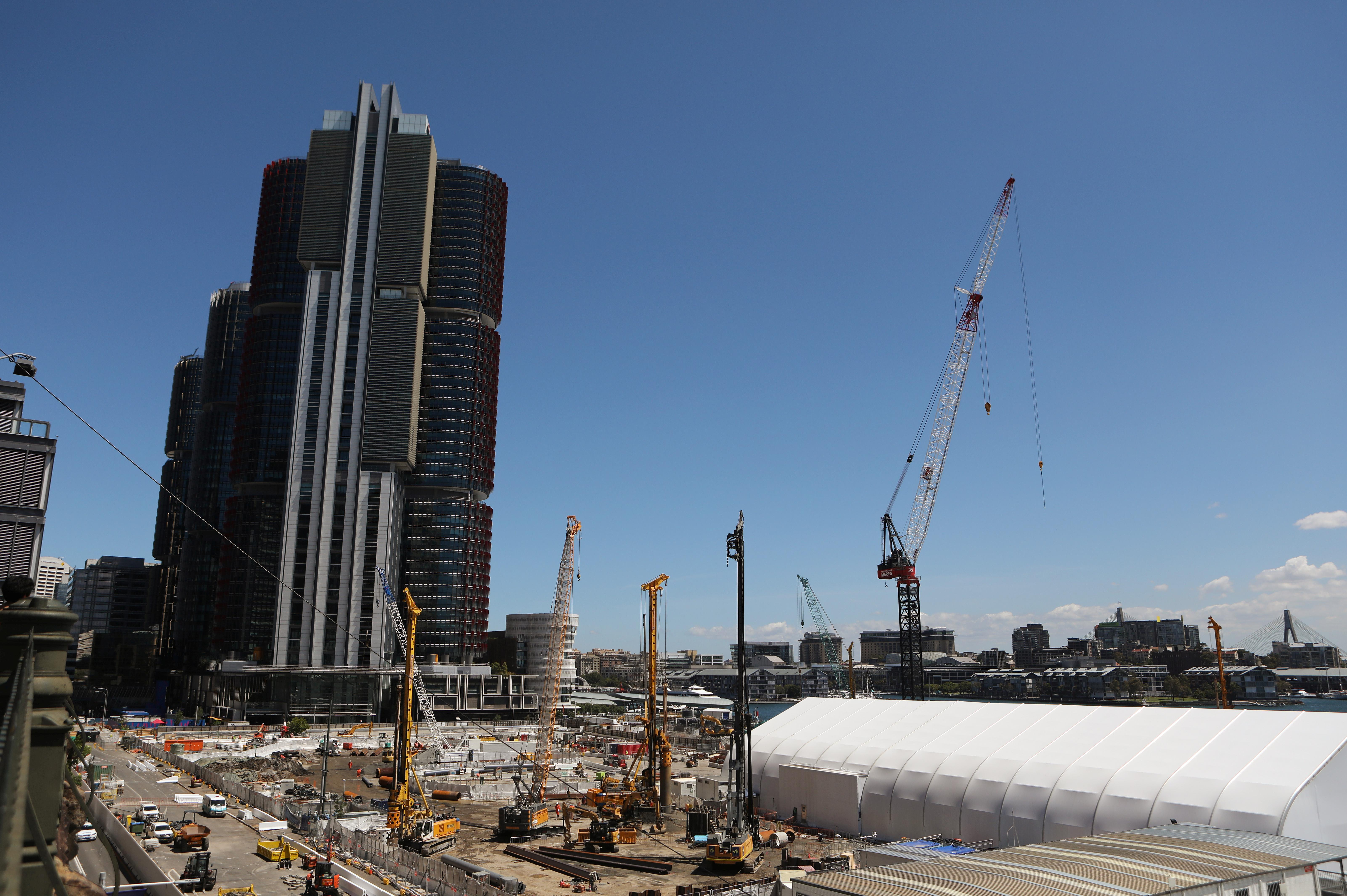 Cranes and heavy machinery are seen on a huge construction site next to Barangaroo building complex in Sydney