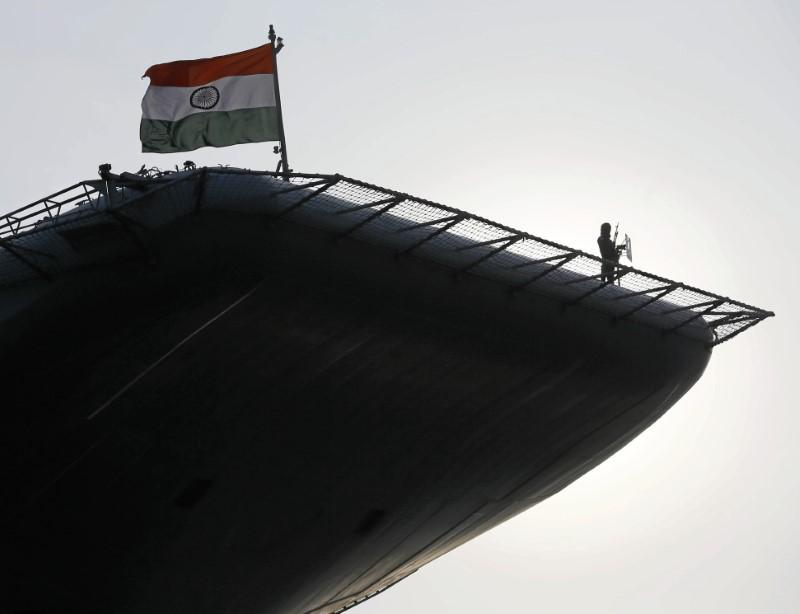 An Indian soldier stands guard on Indian Navy's largest aircraft carrier INS Vikramaditya at Colombo port in Sri Lanka January 21, 2016. Dinuka Liyanawatte