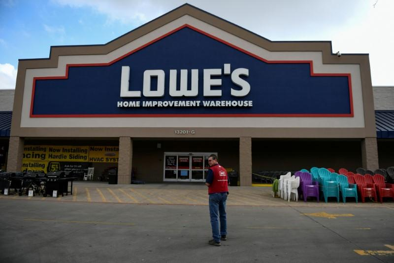 An employee stands outside a Lowe's home improvement chain in Austin, Texas, U.S., February 27, 2017. Mohammad Khursheed