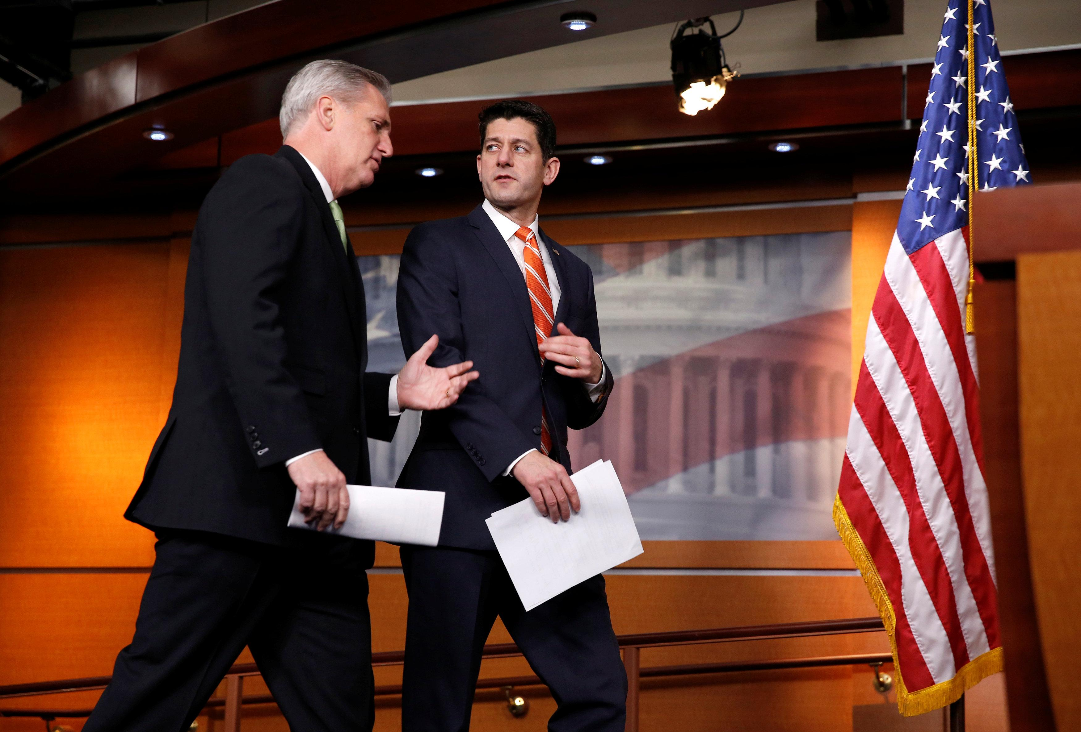 Speaker of the House Paul Ryan (R-WI) walk with House Majority Leader Kevin McCarthy (R-CA) during a news conference after a House Republican caucus meeting on Capitol Hill in Washington, U.S., January 17, 2018.      Joshua Roberts
