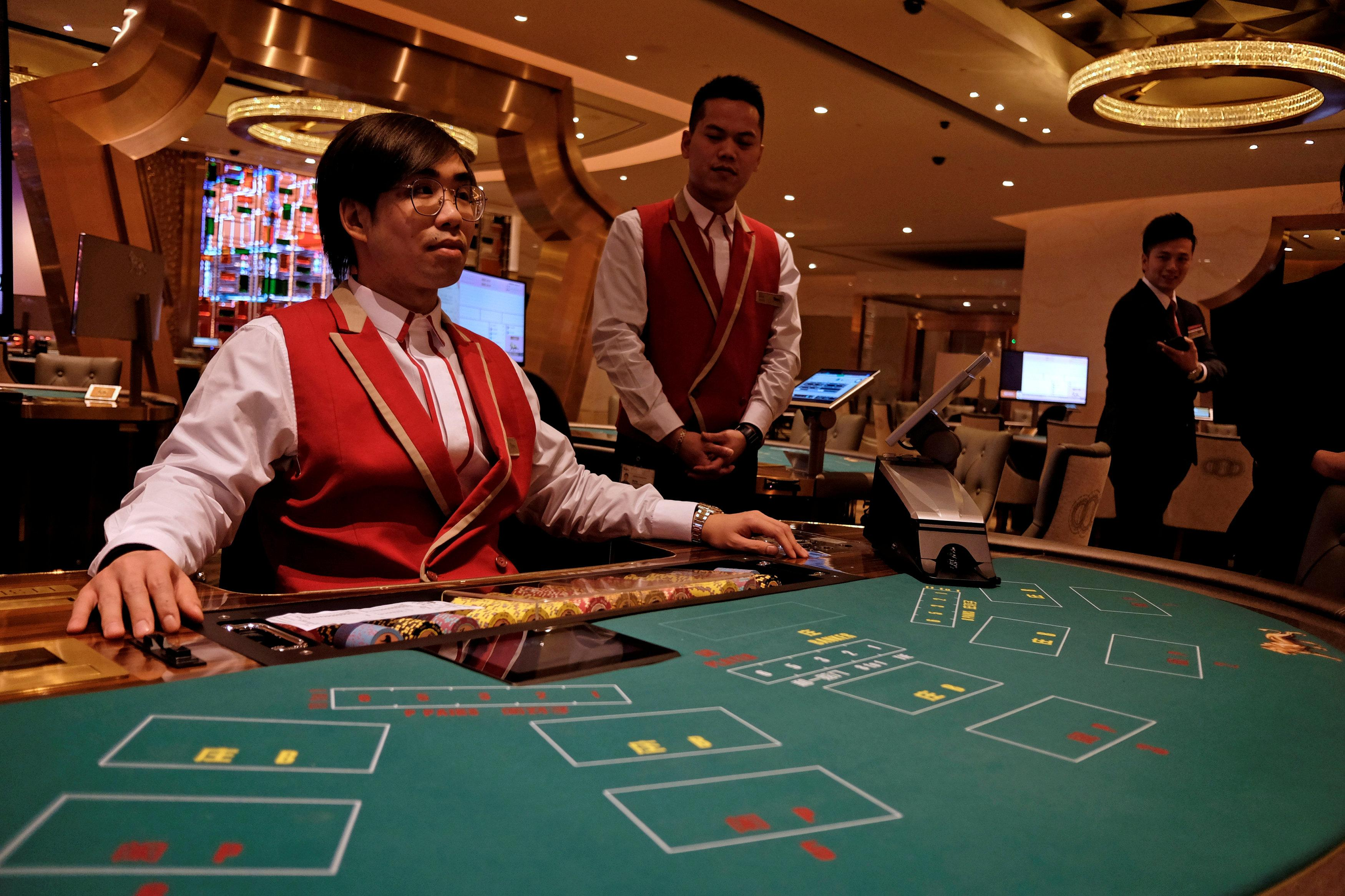 Employees inside the casino prepare for the opening of MGM Cotai in Macau, China February 13, 2018. Bobby Yip