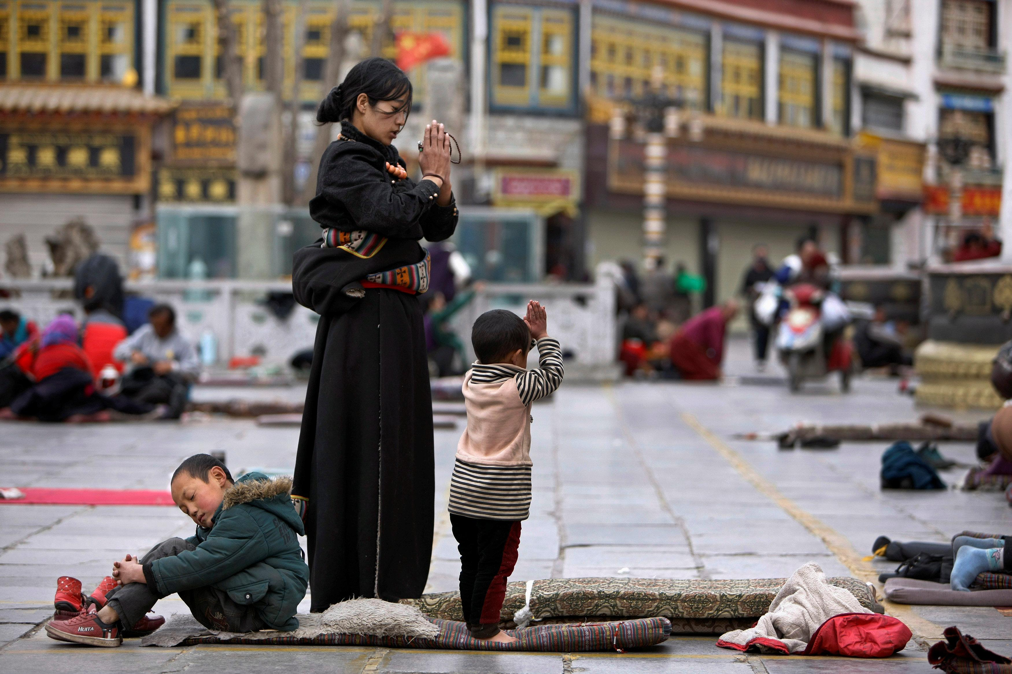Tibetans pray outside Jokhang Monastery ahead of Tibetan New Year