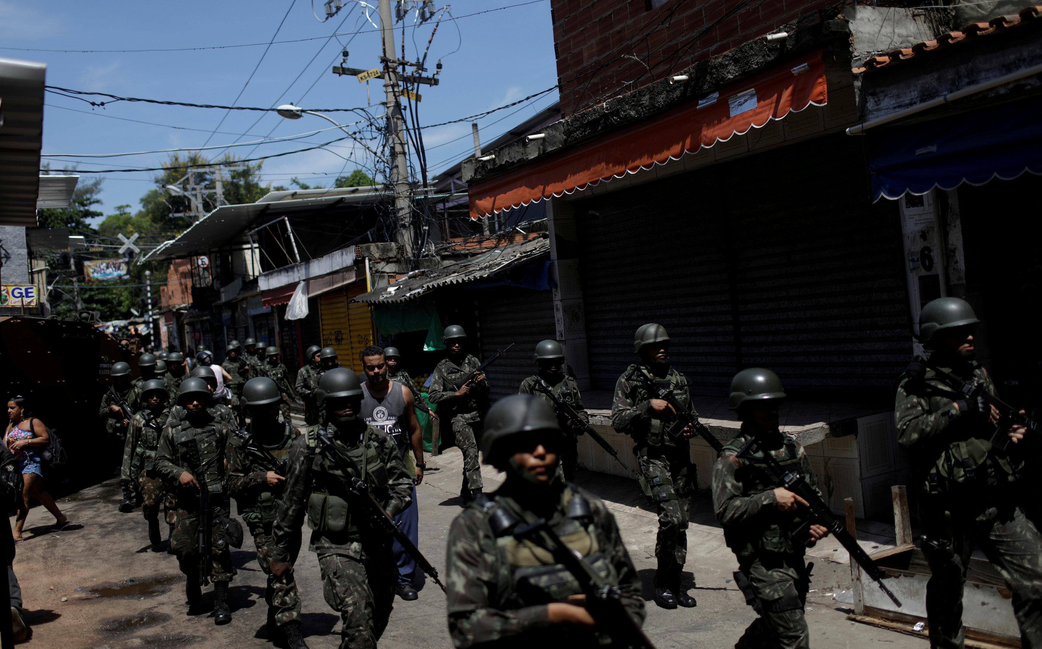 Armed Forces members patrol in Jacarezinho slum during an operation against drug gangs in Rio de Janeiro, Brazil January 18, 2018. Ricardo Moraes/File photo