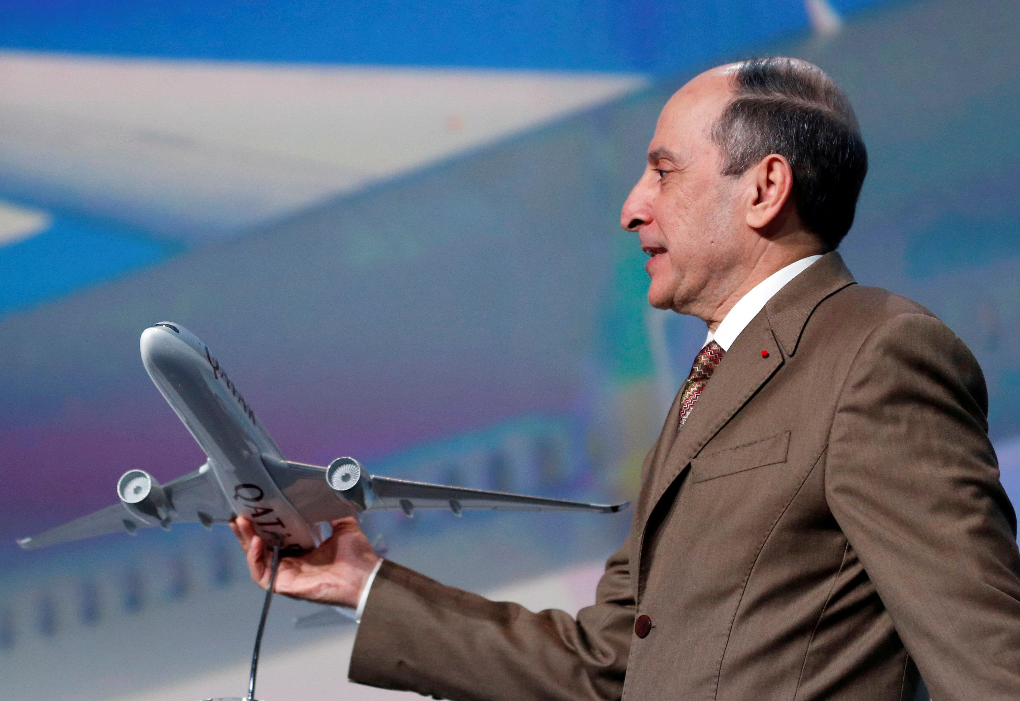 Qatar Airways Chief Executive Akbar Al Baker holds a scale model of a Qatar Airways Airbus A350-1000 during a news conference in Blagnac near Toulouse, France, February 20, 2018. Regis Duvignau