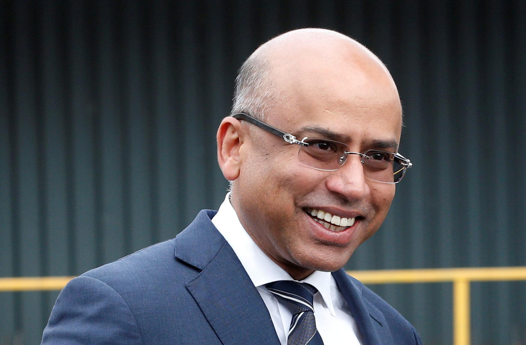 Liberty Steel's Sanjeev Gupta smiles outside their newly acquired Liberty Steel processing mill in Dalzell, Scotland, Britain April 8, 2016. Russell Cheyne/File photo