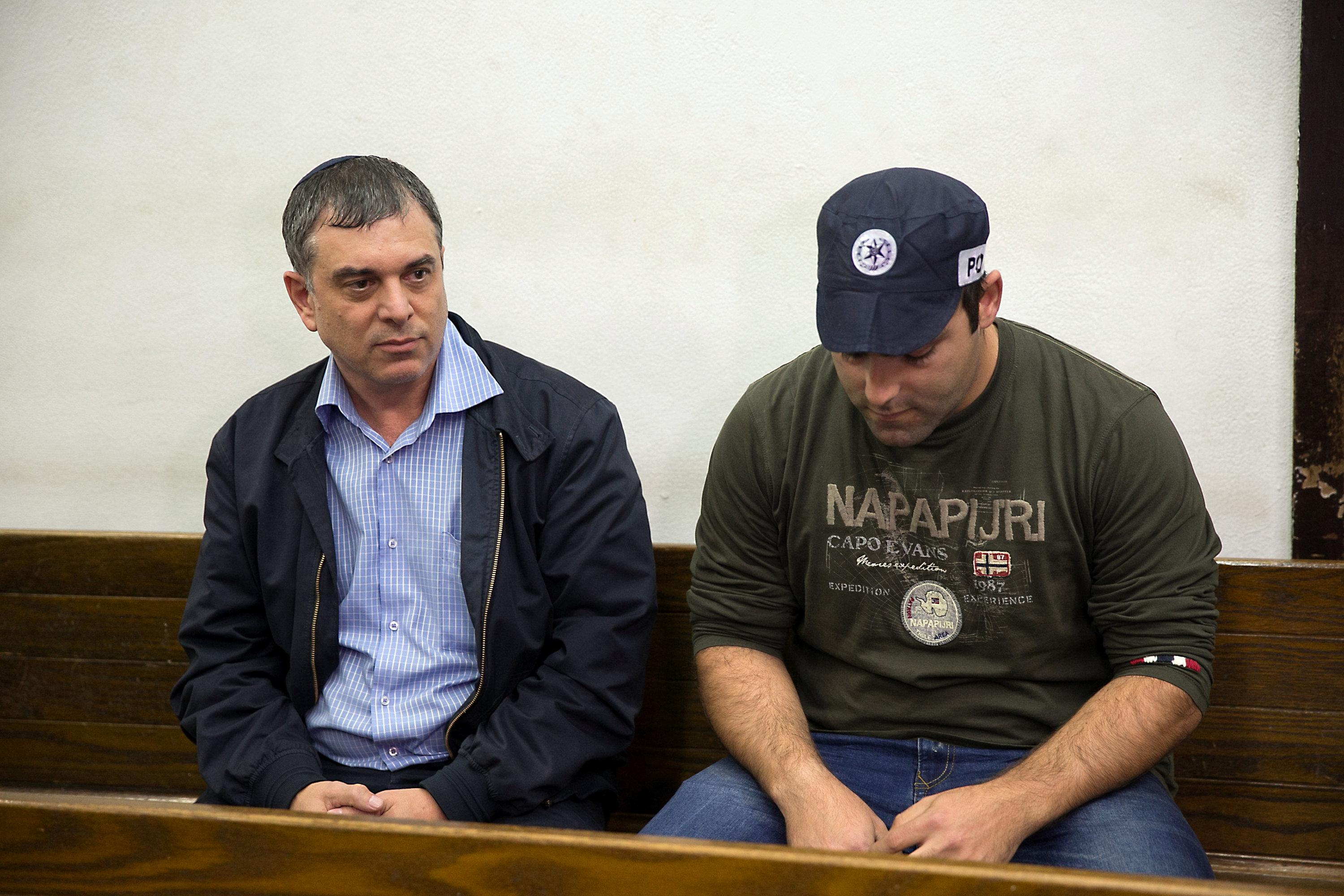 Shlomo Filber (L) sits at the Magistrate Court during his remand in Tel Aviv, Israel, February 18, 2018.  Stringer