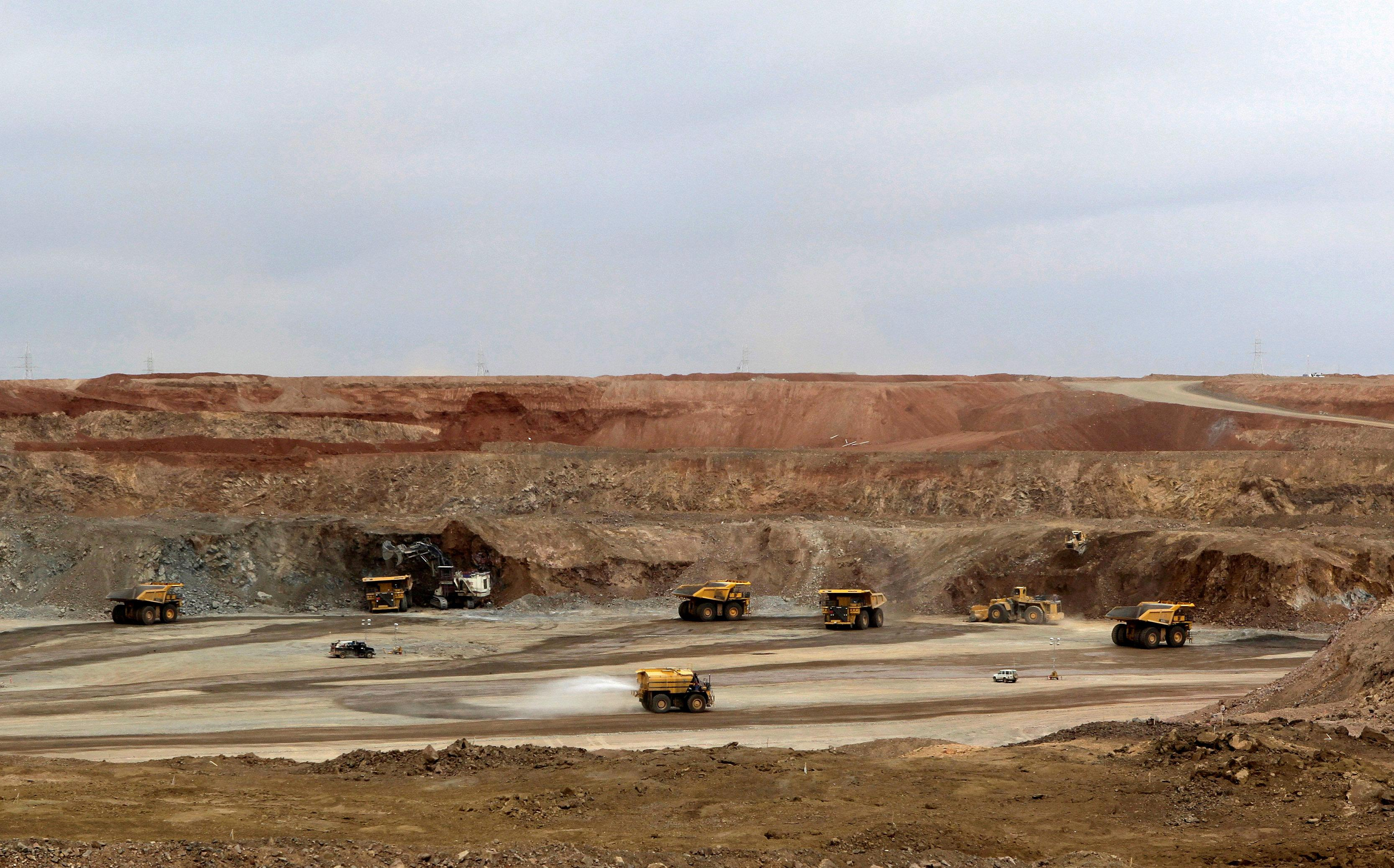 Mining trucks are seen at the Oyu Tolgoi mine in Mongolia's South Gobi region June 23, 2012. David Stanway