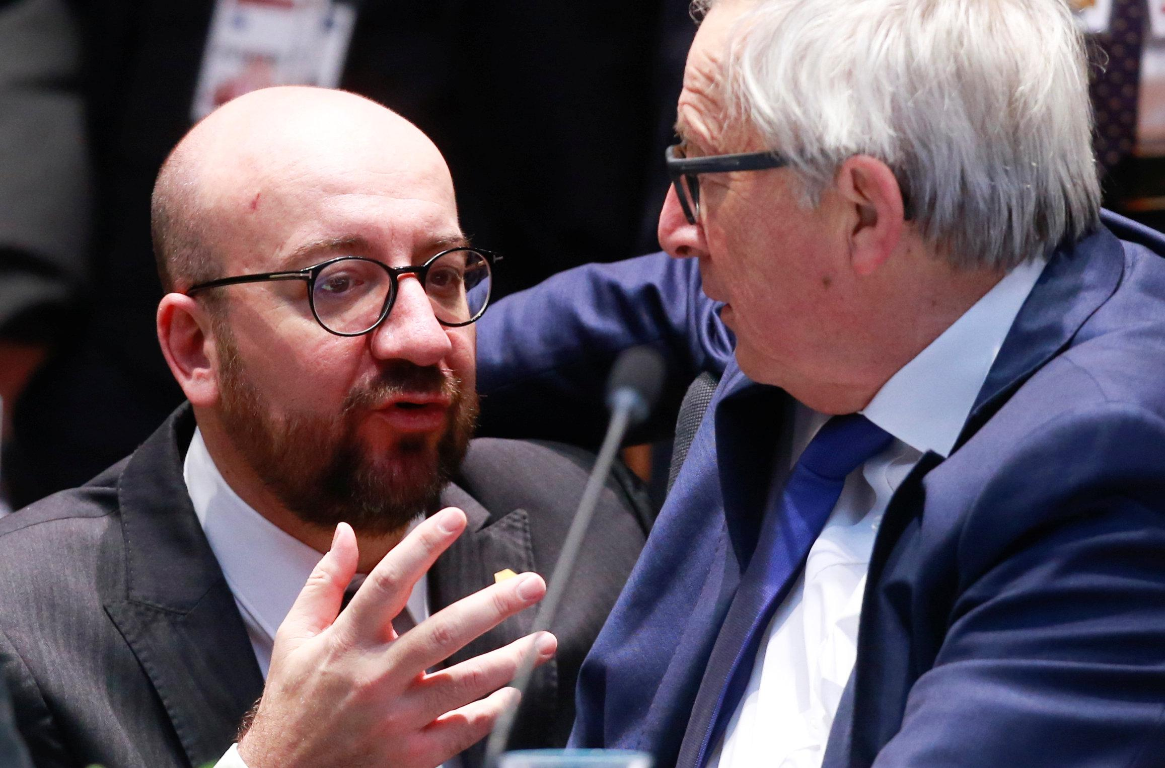Belgium's Prime Minister Charles Michel and European Commission President Jean-Claude Juncker attend the European Union leaders summit in Brussels, Belgium, March 23, 2018. Olivier Hoslet/Pool via Reuters