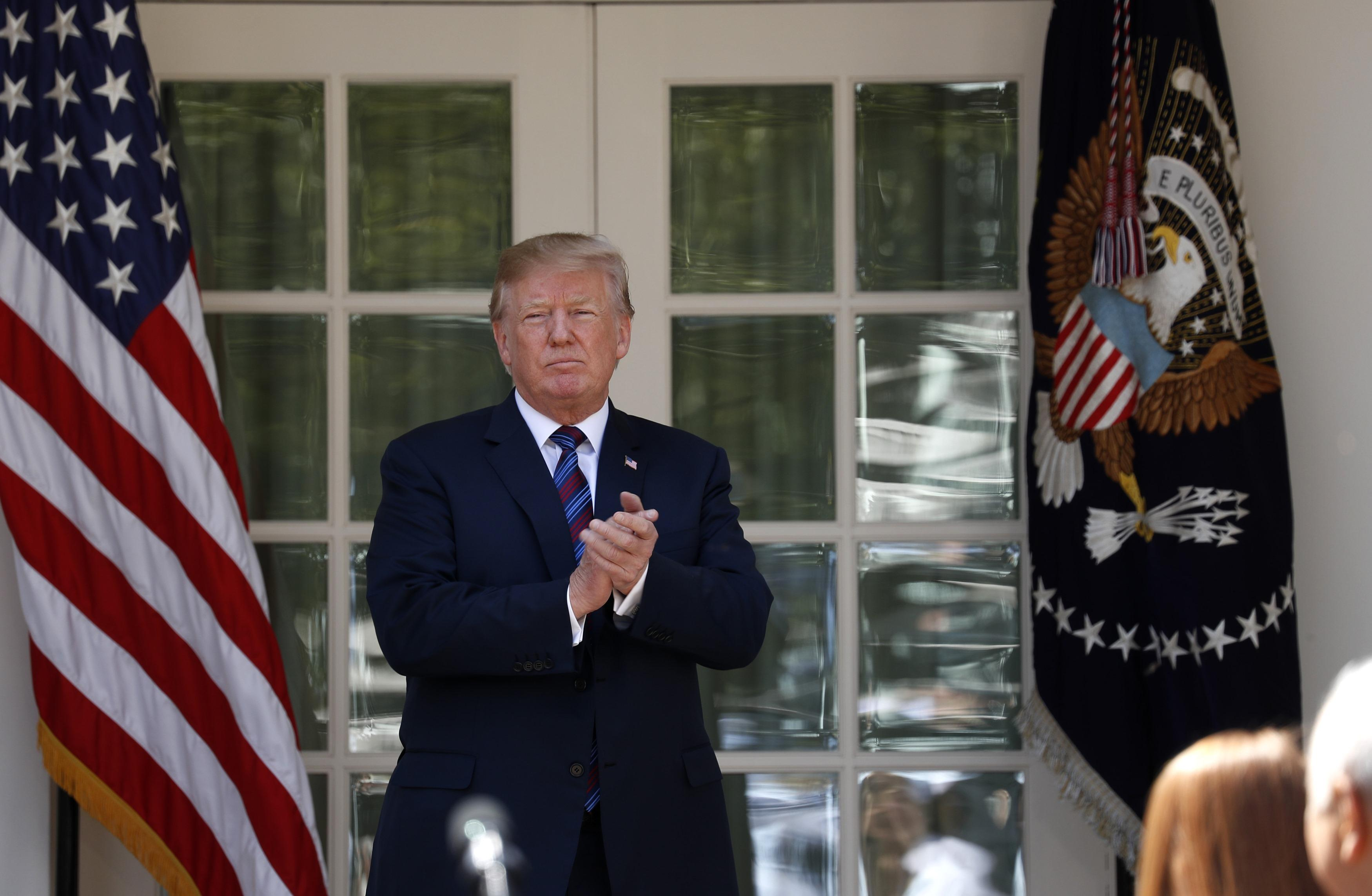 U.S. President Donald Trump departs after giving remarks on tax cuts for American workers during an event in the White House Rose Garden in Washington, U.S., April 12, 2018. Kevin Lamarque
