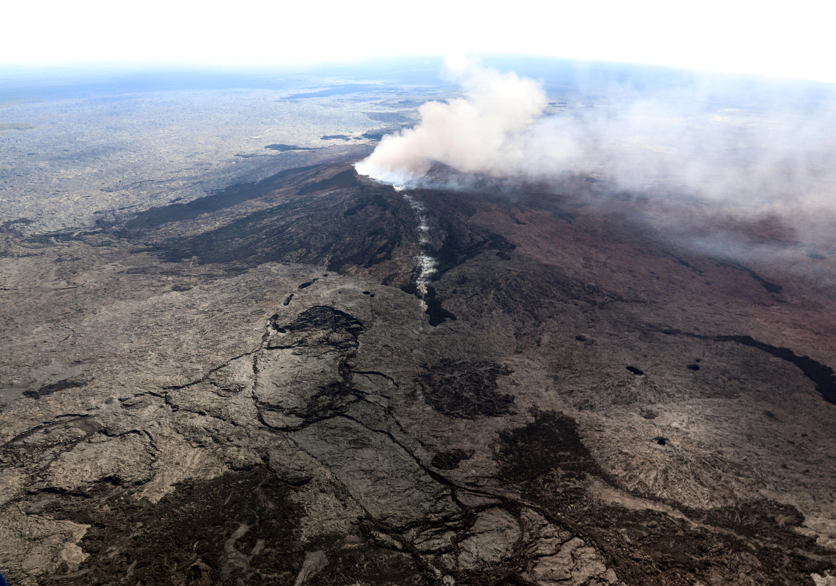 The Kilauea Volcano fissure that formed on the west flank of the Pu'u 'O'o cone (line of white steam) is seen in this aerial image after the volcano erupted following a series of earthquakes over the last couple of days, in Hawaii, U.S. on May 3, 2018. Picture taken on May 3, 2018.  USGS/Handout via