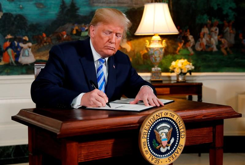 In a May 8 event at the White House, U.S. President Donald Trump signs a proclamation declaring his intention to withdraw from the Iran nuclear agreement. Jonathan Ernst