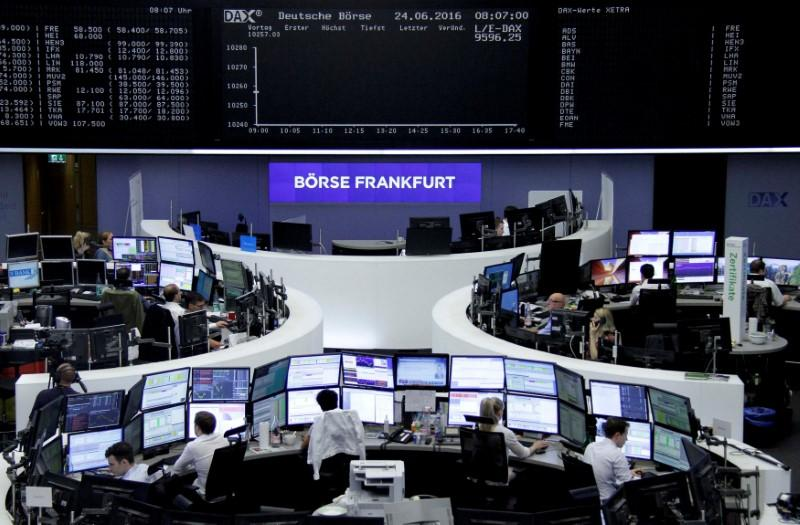 Traders prepare before the opening of the German stock exchange in front of the empty DAX board, at the stock exchange in Frankfurt, Germany, June 24, 2016.    Staff/Remote