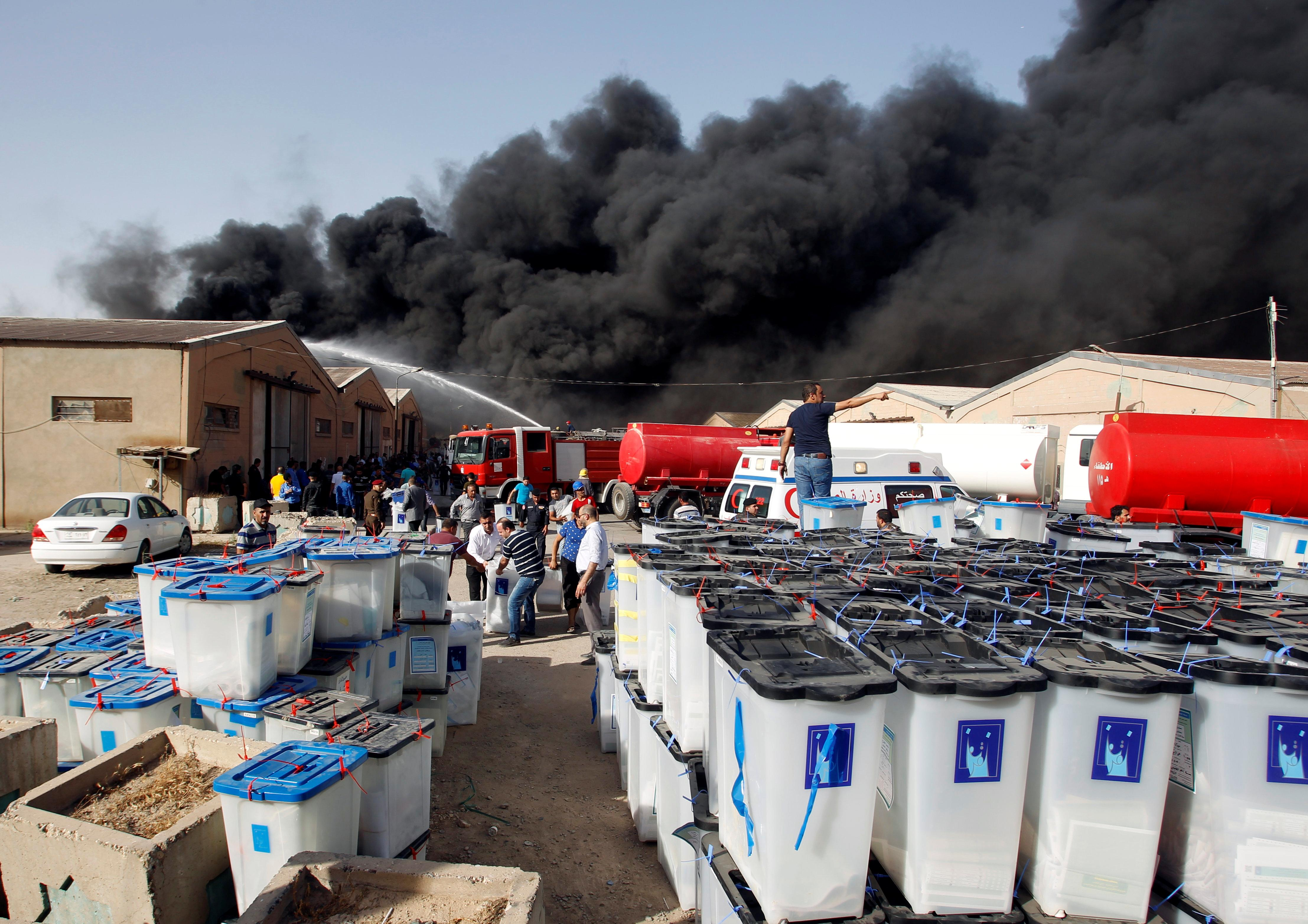Smoke rises from a  Baghdad storage site housing ballot boxes from Iraq's May parliamentary election, June 10, 2018. Khalid al-Mousily -