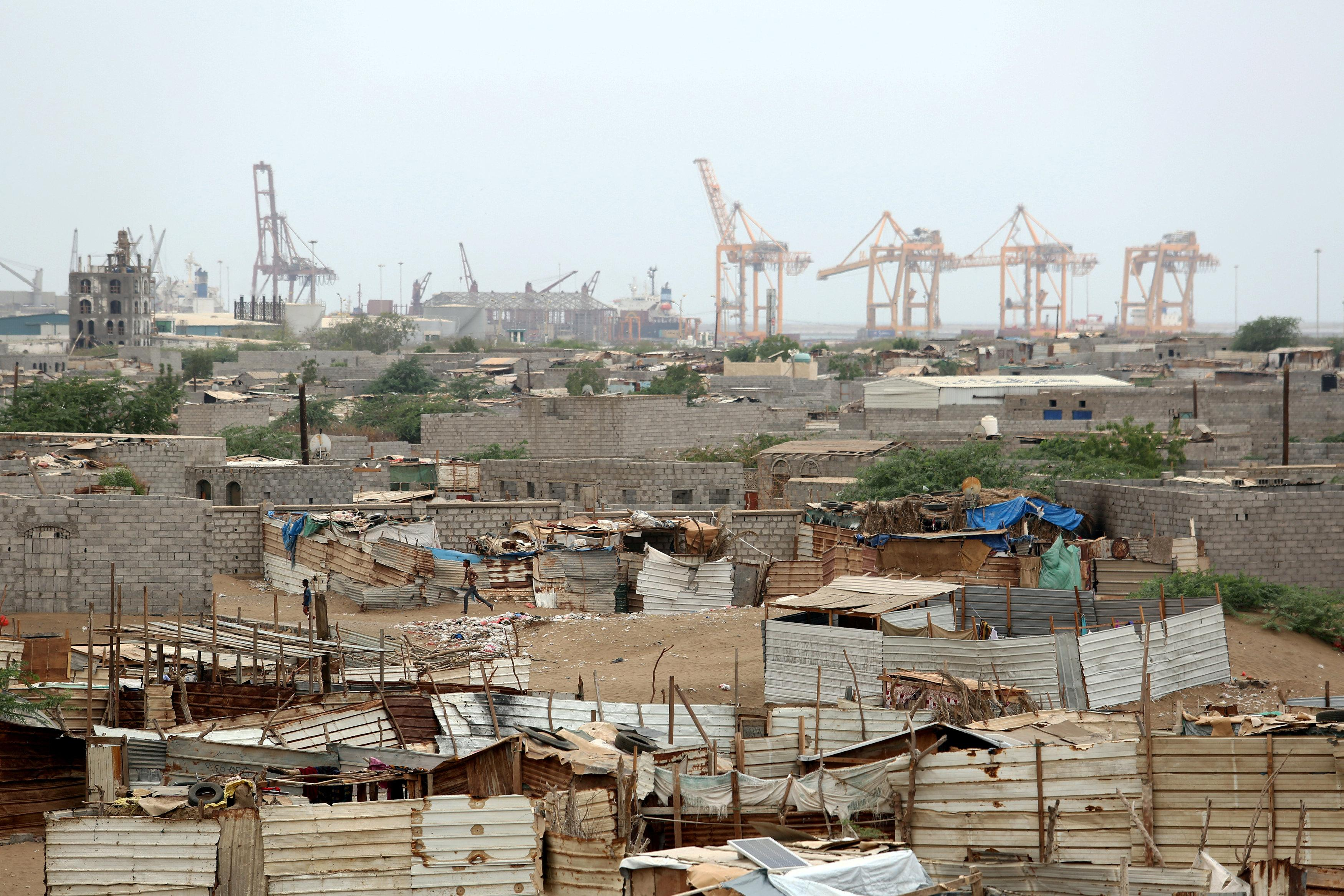Hodeidah port's cranes are pictured from a nearby shantytown in Hodeidah, Yemen June 16, 2018. Abduljabbar Zeyad