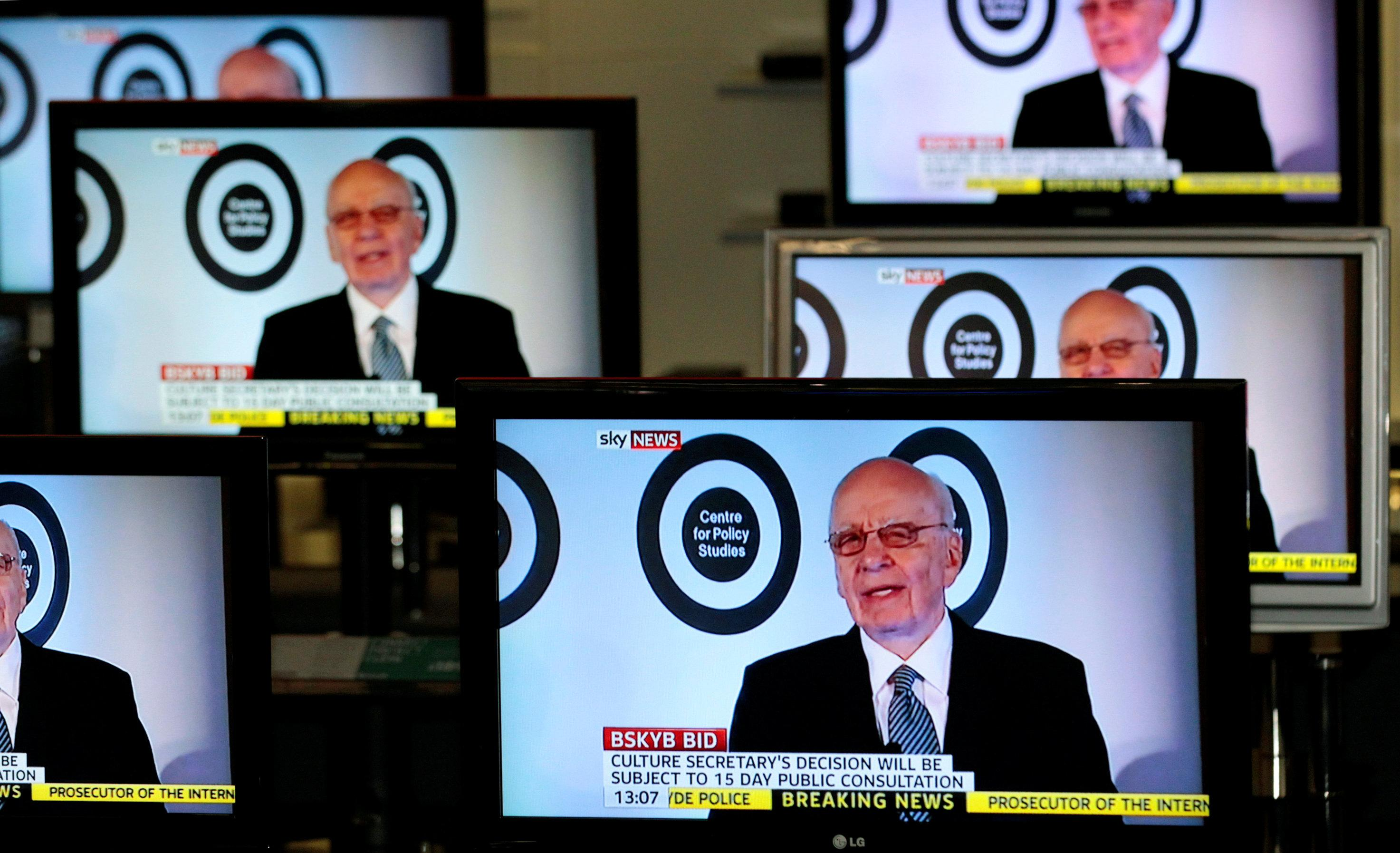 The Chairman, and Chief Executive of News Corporation, Rupert Murdoch is seen talking on Sky News on television screens in an electrical store in Edinburgh, March 3, 2011. David Moir