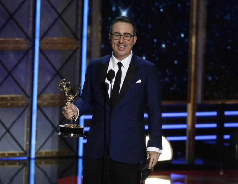 "69th Primetime Emmy Awards – Show – Los Angeles, California, U.S., 17/09/2017 - John Oliver accepts the award for Outstanding Writing for a Variety Series for ""Last Week Tonight with John Oliver."" Mario Anzuoni"