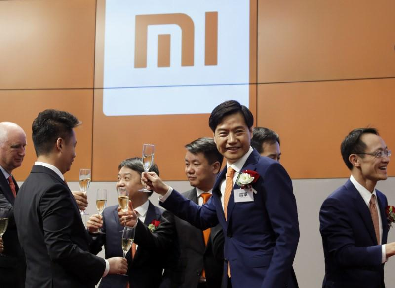 Xiaomi founder, Chairman and CEO Lei Jun (2nd R) attends the listing of the company at the Hong Kong Exchanges in Hong Kong, China July 9, 2018.   Bobby Yip