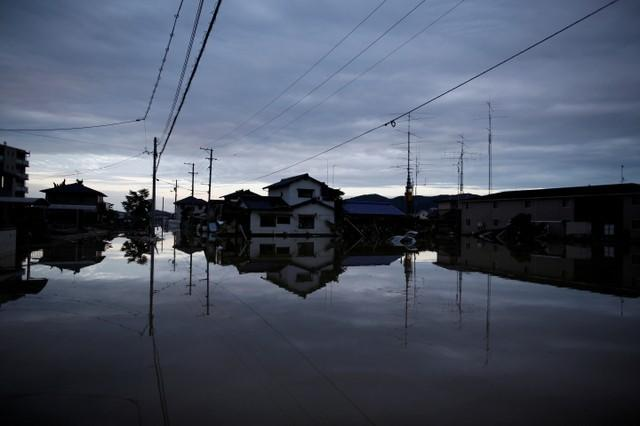 Submerged houses are seen in a flooded area in Mabi town in Kurashiki, Okayama Prefecture, July 8, 2018. Issei Kato