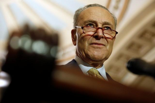 U.S. Senate Democratic leader: Trump 'putting himself over' U.S.