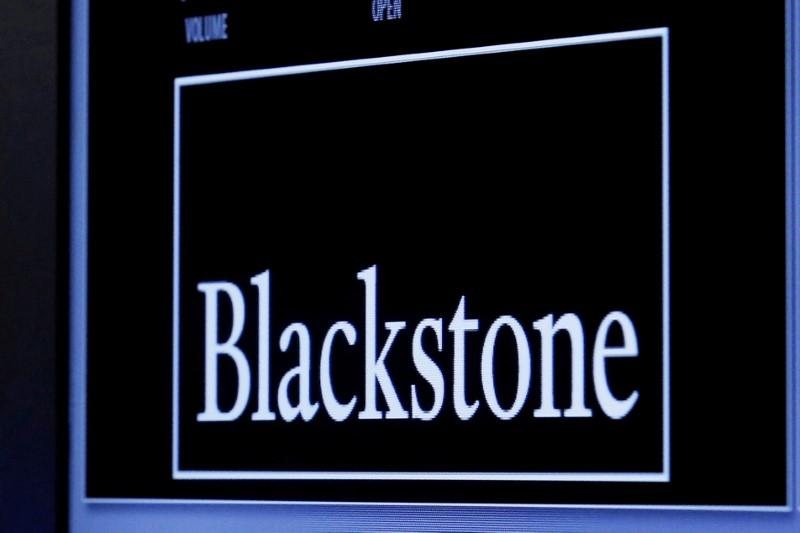 The logo of Blackstone Group is displayed at the post where it is traded on the floor of the New York Stock Exchange (NYSE) April 4, 2016. Brendan McDermid
