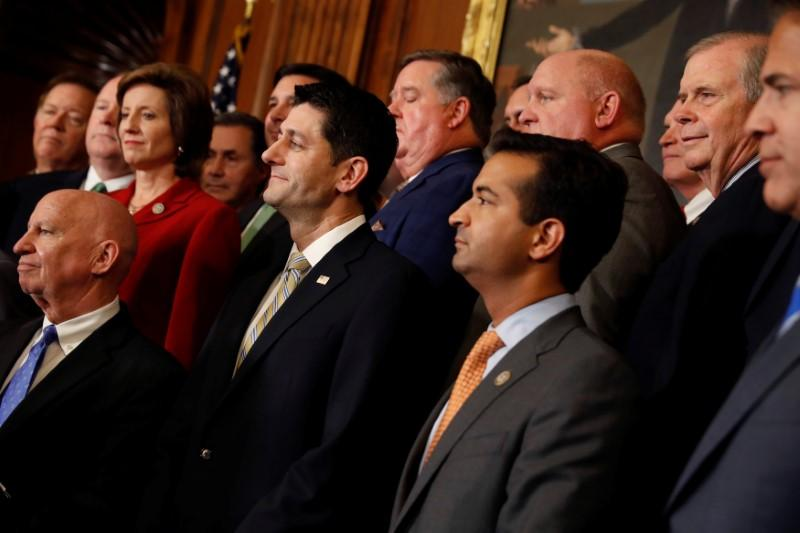 Rep. Kevin Brady (R-TX), Speaker of the House Paul Ryan and Rep. Carlos Curbelo (R-FL) look on during a news conference announcing the passage of the