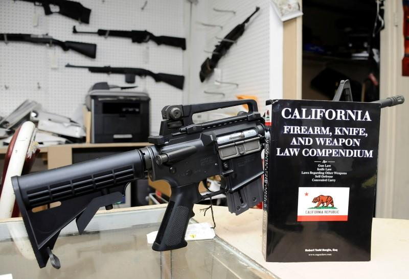 A 736-page California gun law book is on display along with guns at Aegis Trading Enterprises gun shop in Burbank, California, U.S., December 19, 2012.  Gene Blevins
