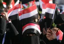A female supporter of Yemen's President Abd-Rabbu Mansour Hadi attends a rally marking the first anniversary of his election in the southern port city of Aden February 21, 2013. REUTERS/Khaled Abdullah (YEMEN - Tags: POLITICS ELECTIONS ANNIVERSARY) - RTR3E2Y1