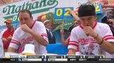 Hot dog eating champ gobbles down 61 hot dogs