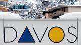 Davos elites walking in Trump's shadow